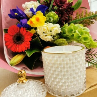 Luxury candle and blooms
